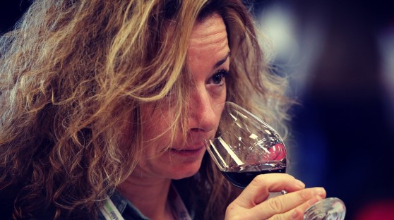 People visit a stand of the Millesime Bio 2018, an international organic wine fair, on January 30, 2018 in Montpellier. The event aims at promoting wines made from organically grown grapes and features new vintages for buyers.